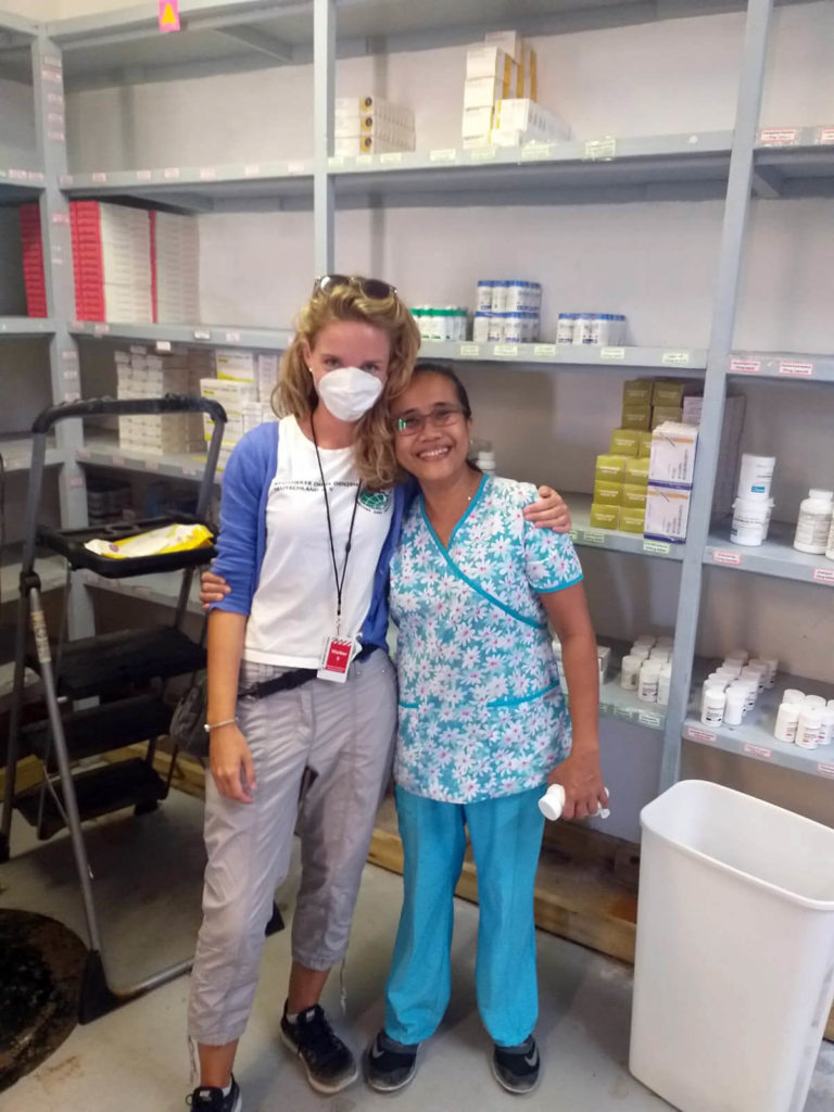 Kristin poses with Rand Memorial Hospital Pharmacist Judith Villahermosa at the pharmacy warehouse.