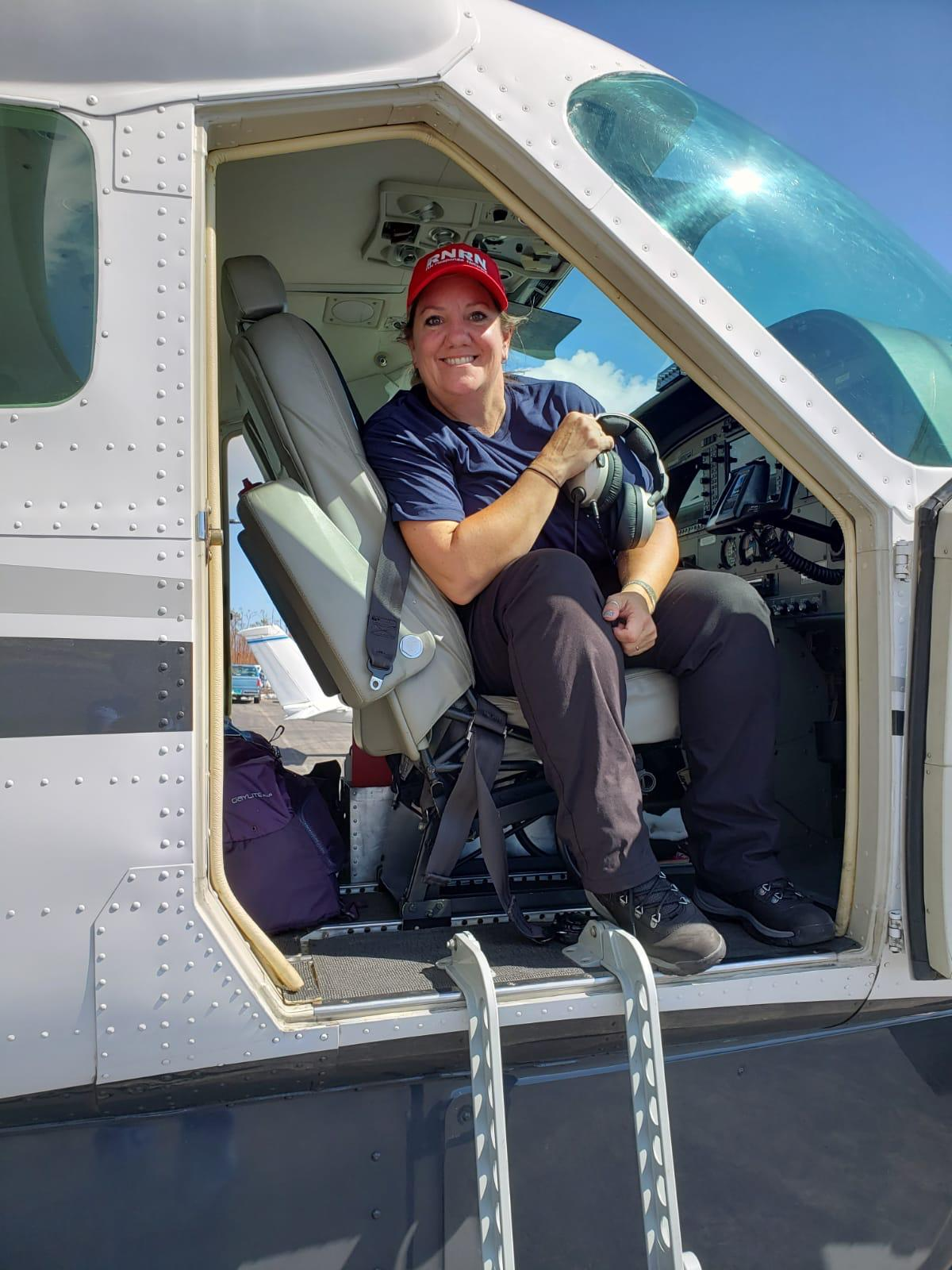 Amy Bowen, ER and Flight Nurse, boards a helicopter to Abaco.