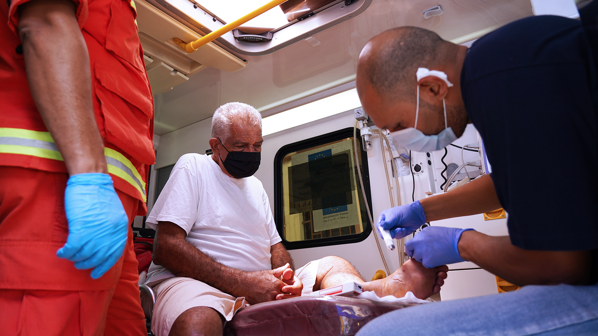 On August 9, Rabih, a health officer and a registered nurse who usually works for International Medical Corps in the south of Lebanon, was deployed to Beirut to help with the emergency response in the wake of the port explosion. Here, he treats an elderly patient at the Mobile Medical Unit deployed to the Karm El Zaytoun neighborhood.