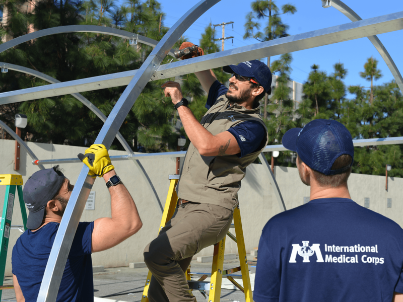 International Medical Corps staff members set up an emergency shelters at the University of Southern California (USC) Medical Center in Los Angeles, CA, on March 30, 2020.