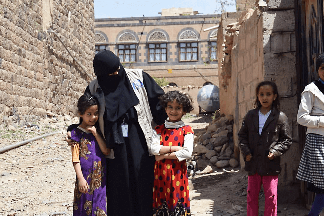 In a photo taken before the COVID -19 pandemic reached Yemen, Dr. Khaled talks with young girls during a cholera-awareness event in Sana'a Governorate's Sanhan District.