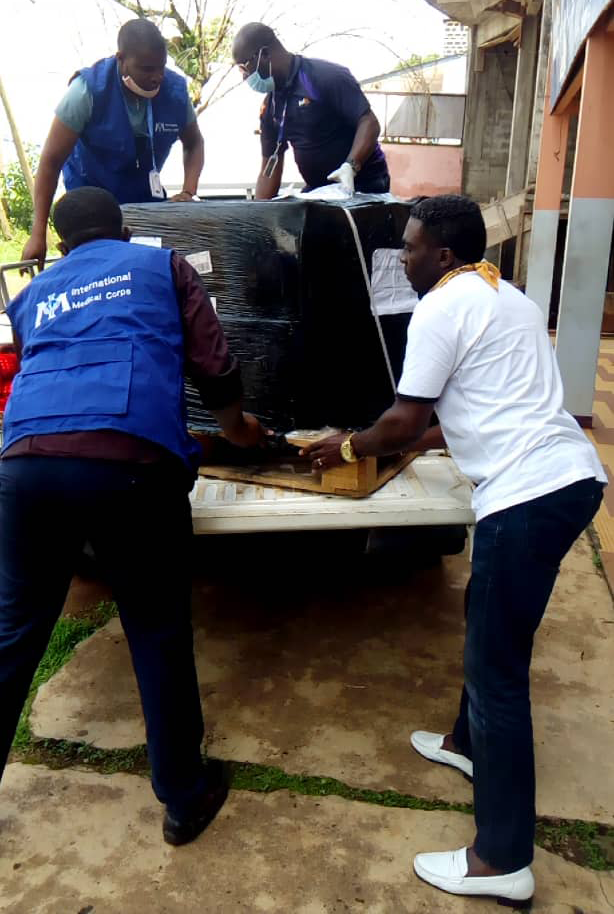 International Medical Corps staff members in Cameroon unload a shipment of PPE from a truck in June.