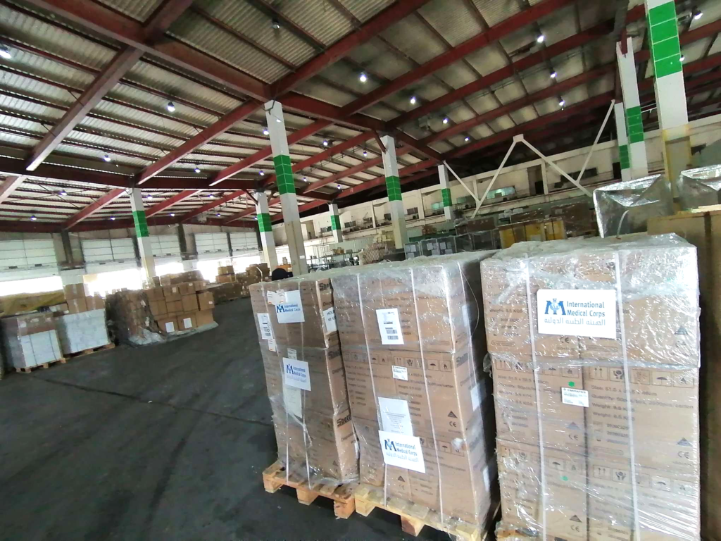 Donations of PPE from International Medical Corps are shown in the Ministry of Health's warehouse in Iraq in July.