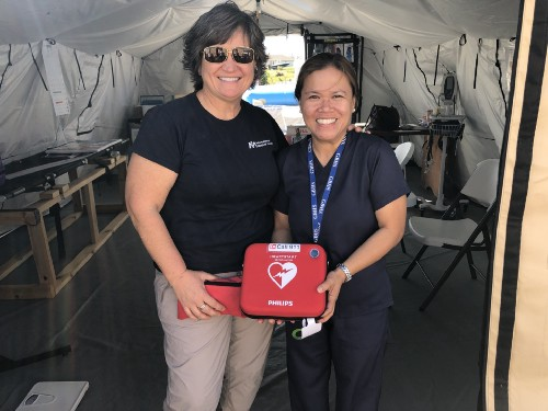 Karen, Health Manager and Abby, Nurse from Grand Bahama Health Services who works at IMC Health Clinic. Providing medical supplies for cardiac emergencies to support both adults and children (AED defbilirator).