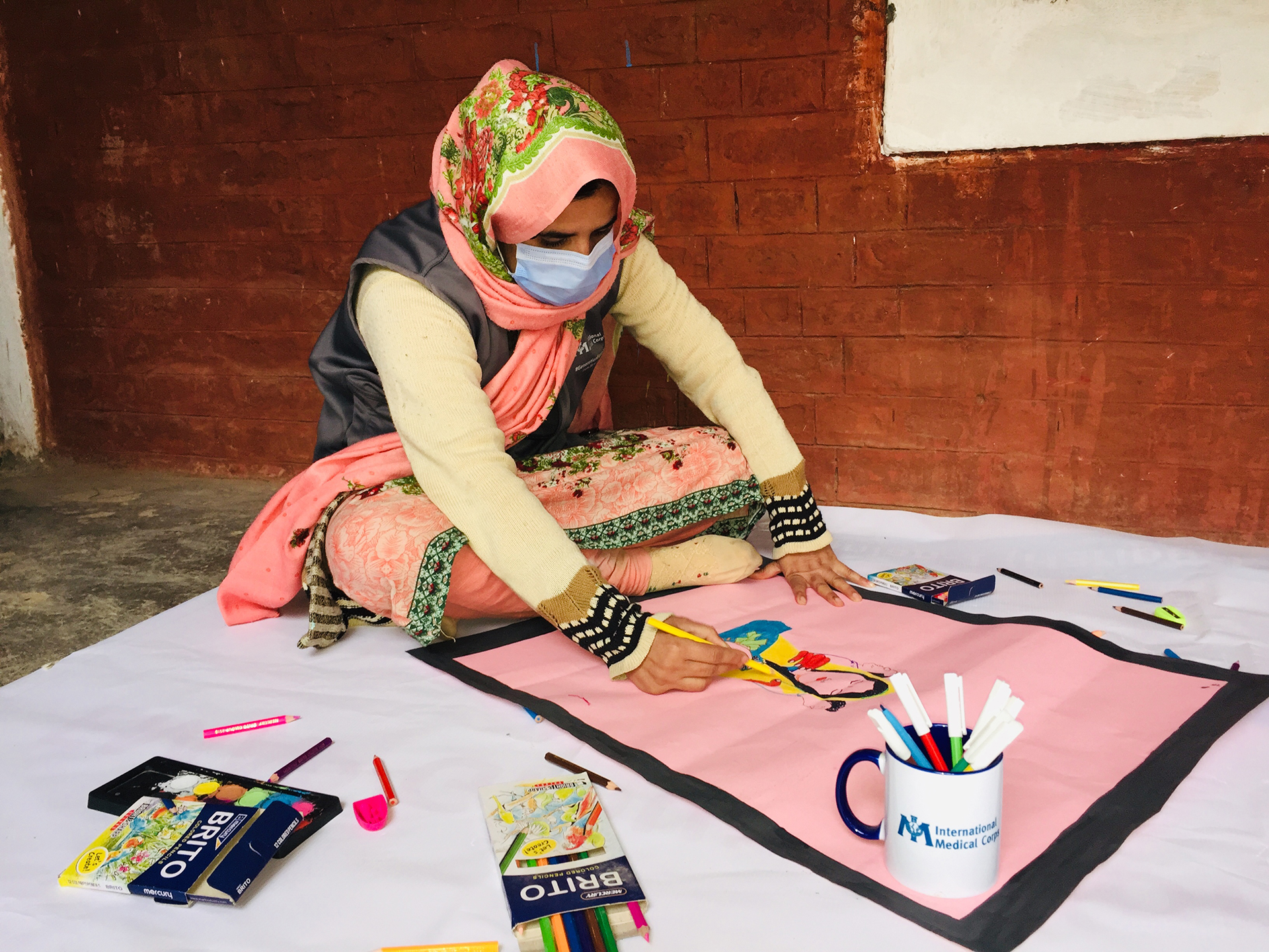 A community member in Khyber Pakhtunkhwa province participates in an art activity during the 16 Days campaign.