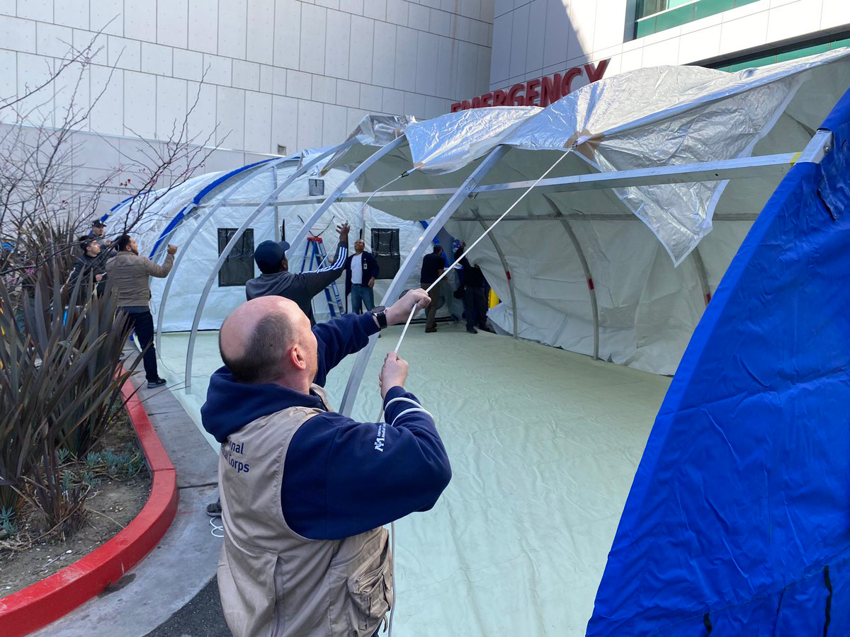 International Medical Corps staff members set up emergency shelters at the Martin Luther King, Jr. Hospital.