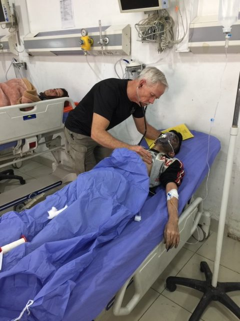 Dr. Mike Paterson treats a Peshmerga soldier who had suffered a blast injury and was severely burned in the 2016 fight against ISIS in Duhok, Iraq.