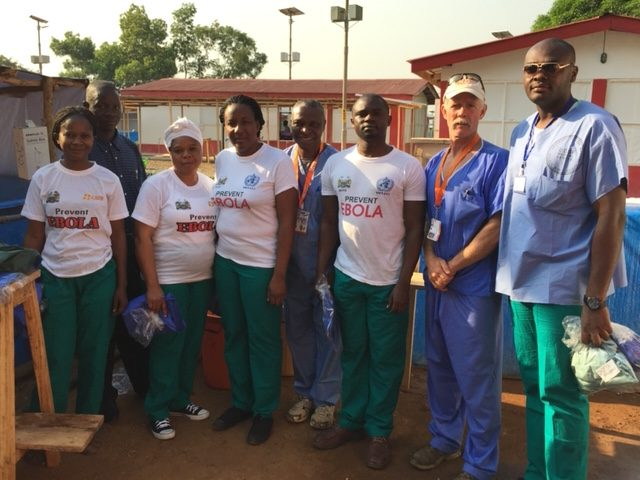 Volunteering in Sierra Leone as part of the Ebola response in West Africa, Dr. Paterson poses with members of the African Union Medical Team after helping open a new Ebola treatment center.