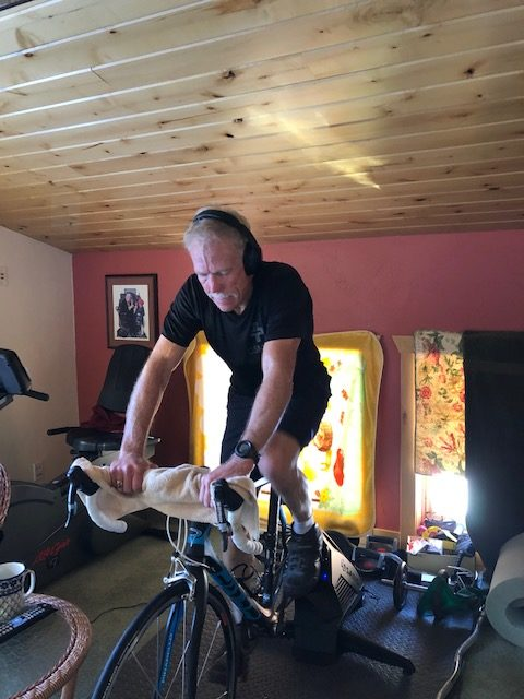 Dr. Paterson on his training bike at home, part of his training regimen as he prepares to climb Mount Everest.