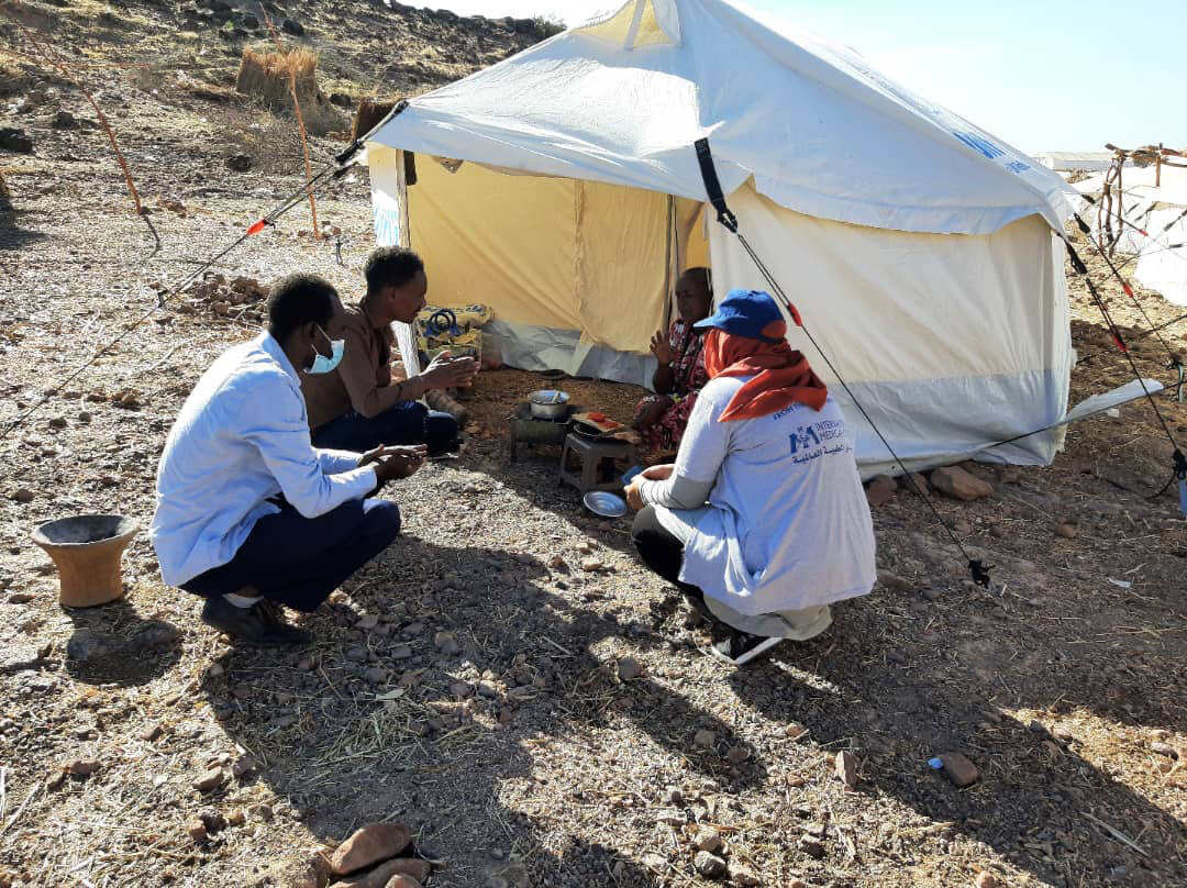 Community health volunteer training on COVID prevention and community engagement in Hamdeyet Camp, Kassala, Sudan.