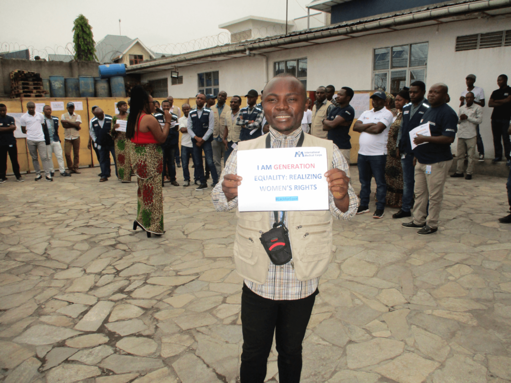 Mussa holds up a sign of support during an International Women's Day event in Goma, North Kivu province.