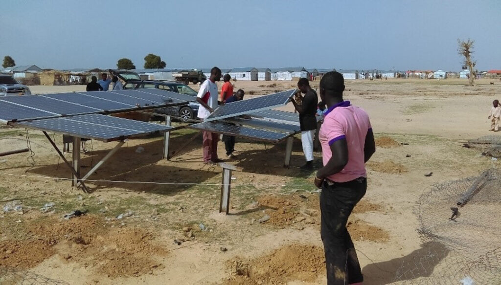 International Medical Corps contractors install solar panels to power the borehole water system in Damboa, Nigeria.