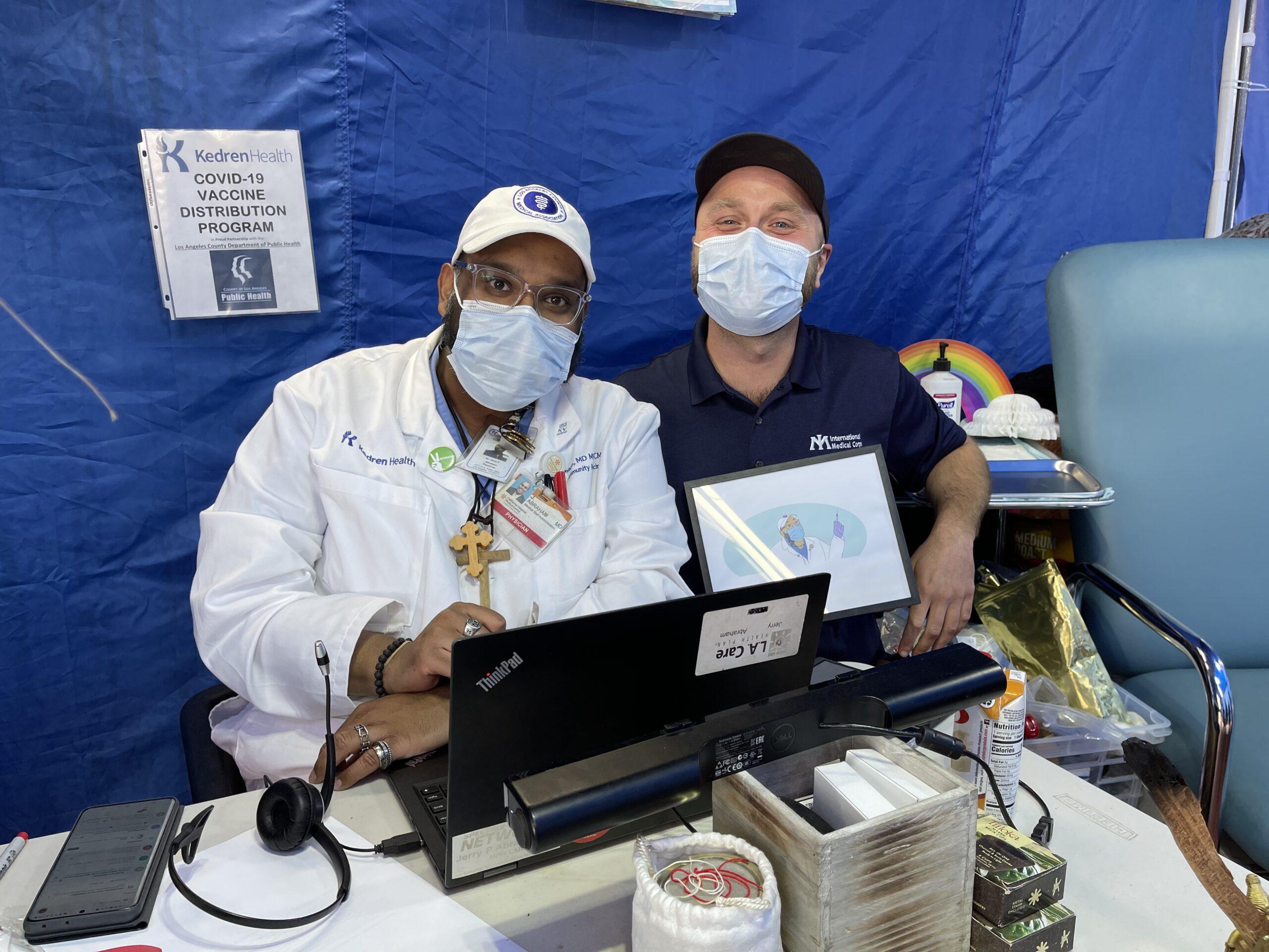 Dr. Jerry Abraham, Director of Vaccines at Kedren, and International Medical Corps ERU Officer Jonah Sargent