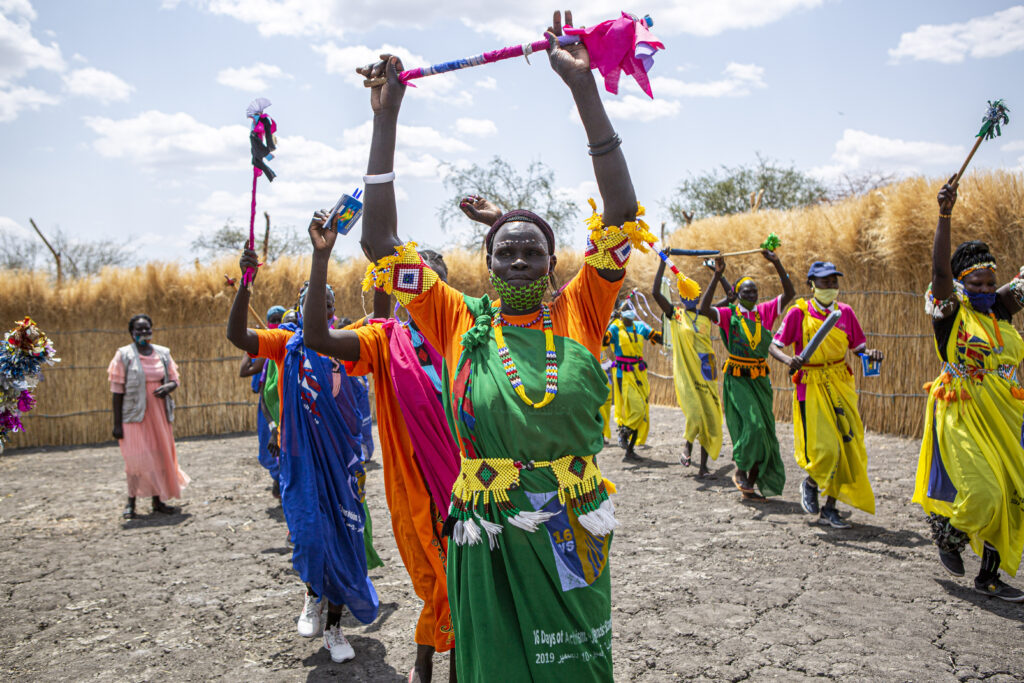 Women dance at a Women and Girls Friendly Space in Aburoch, South Sudan, on March, 18, 2021. International Medical Corps trains women in different activities such as sewing or beading as well as basic literacy and GBV awareness.