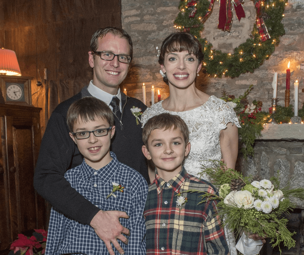 Emile and Greg on their wedding day with Emilie's sons, whom Greg subsequently adopted.