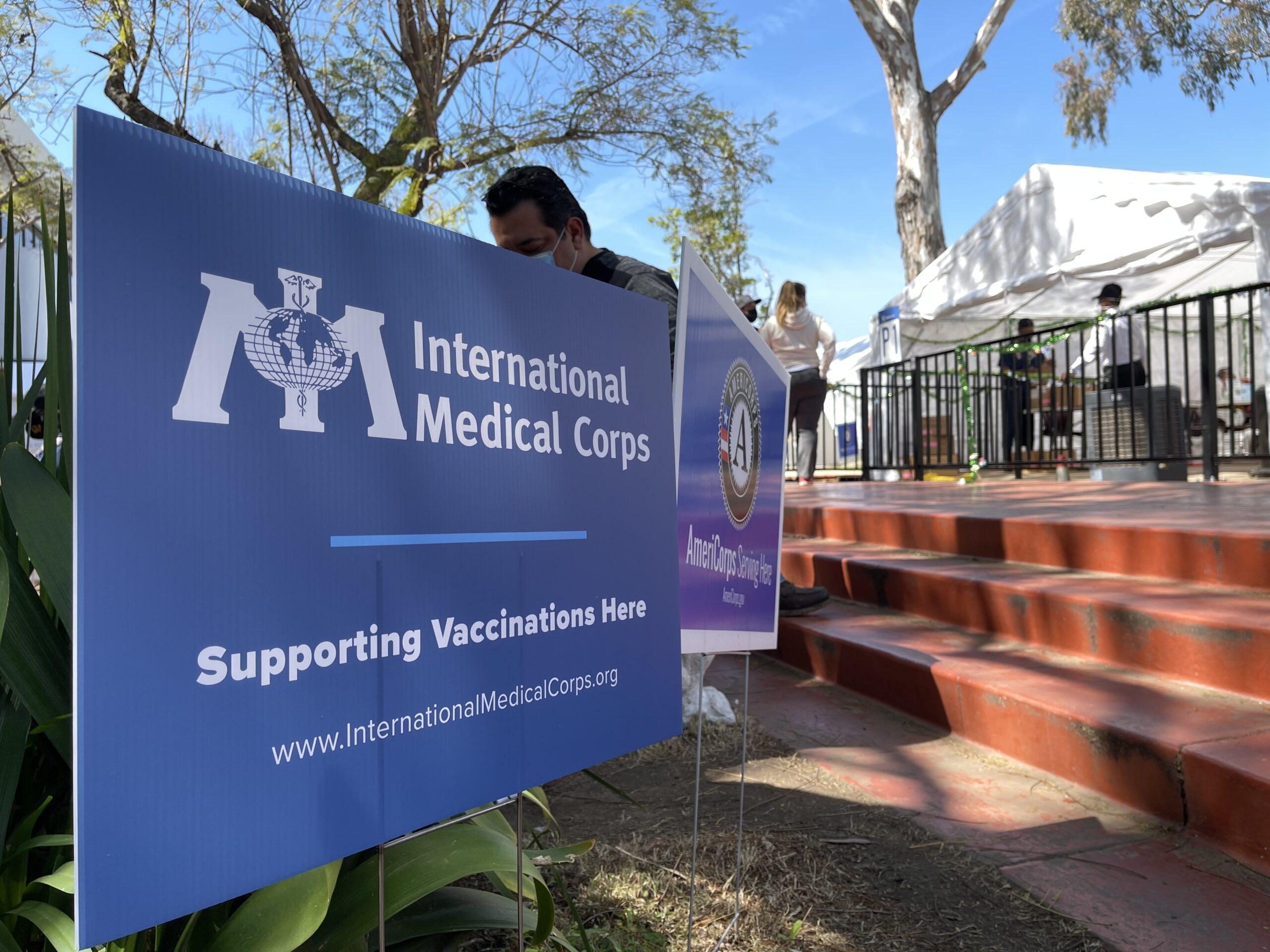 Kedren Community Health Center. International Medical Corps logo signage at the vaccination site.