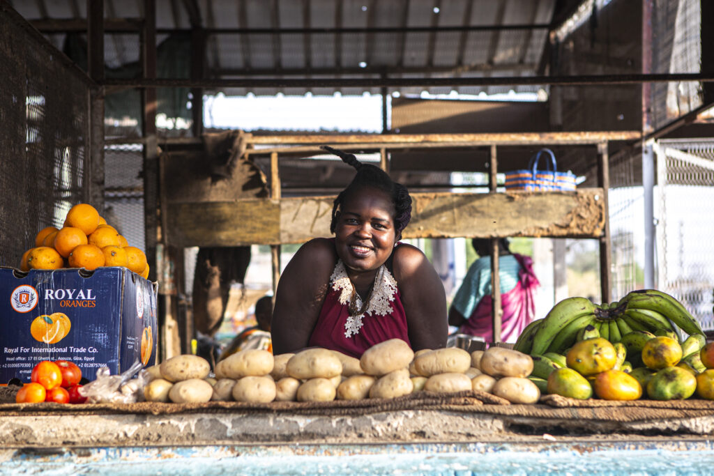 Ayak Andrew, 28, poses for a portrait at her food stand in Malakal, South Sudan, on March 19, 2021.