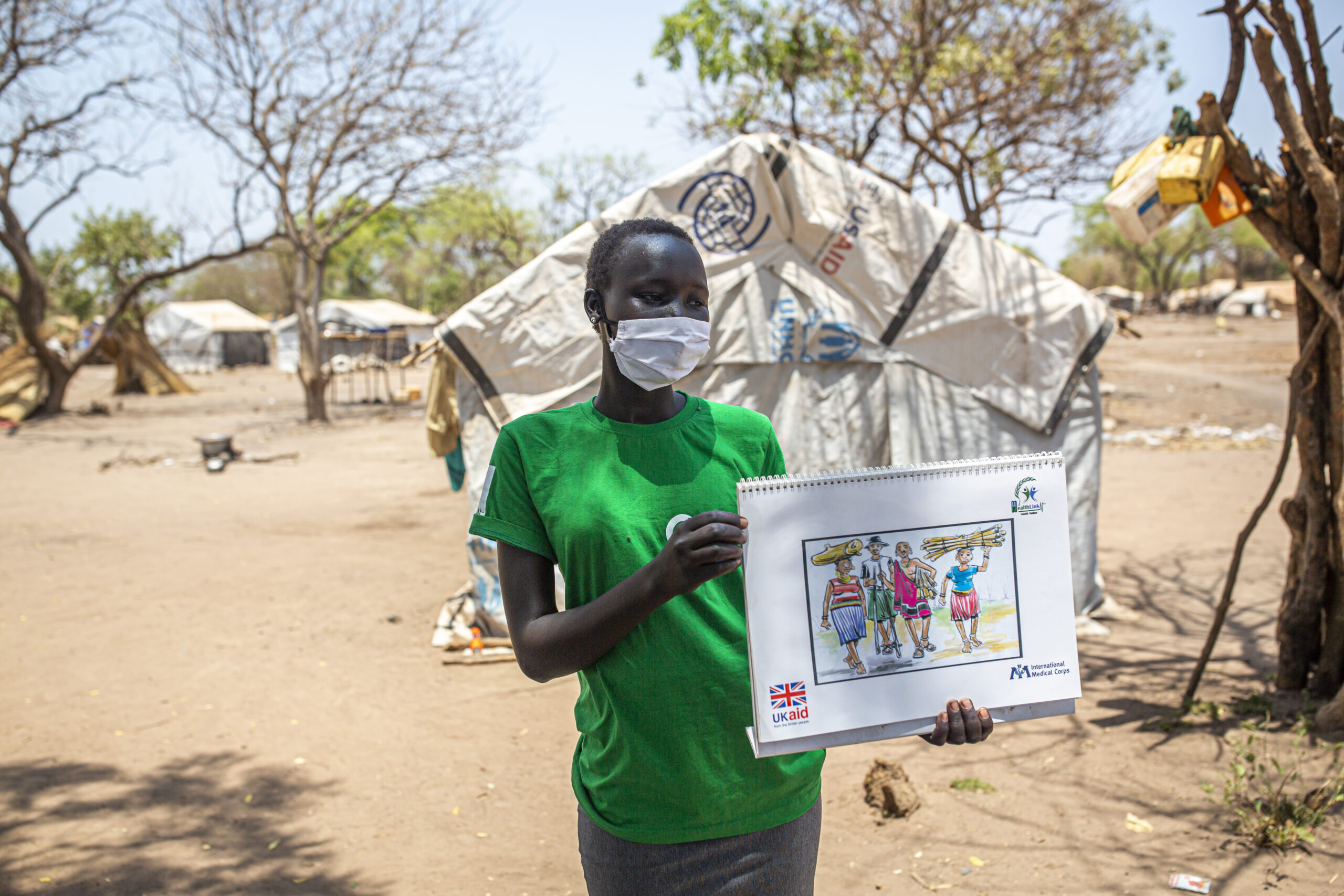 SASA activist from Health Link South Sudan talk to community leaders about GBV in Mangalla, South Sudan, on March 13, 2021.