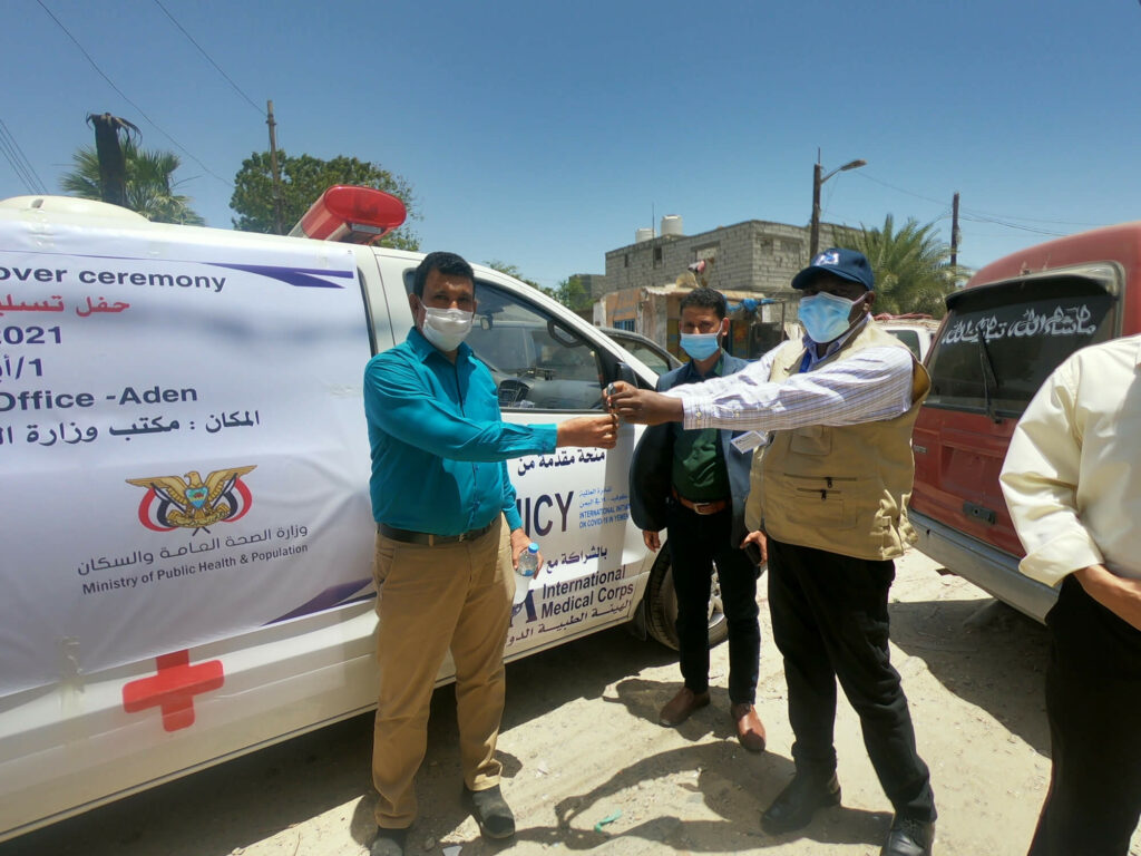 International Medical Corps presents the keys for a new ambulance to the administrator of Al-Mukha Hospital. The vehicle will strengthen the area's patient-referral system.