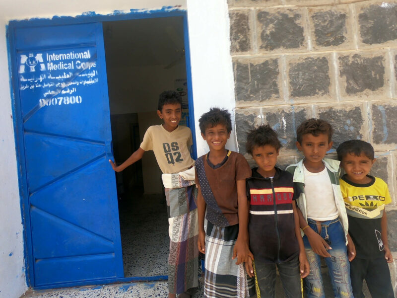Local children pose at the entrance to a primary healthcare clinic we recently renovated in the village of Hessi Salem, north of Al-Mukha.
