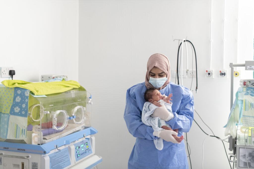NICU nurse Maha bathing a baby at the International Medical Corps - NICU unit in Irbid Specialty Hospital, Irbid, Jordan.