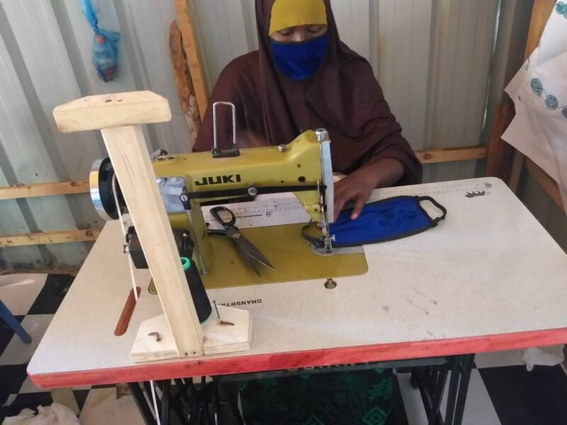 Maryan Abdi Mohammed sews face masks that she will sell in the local market.
