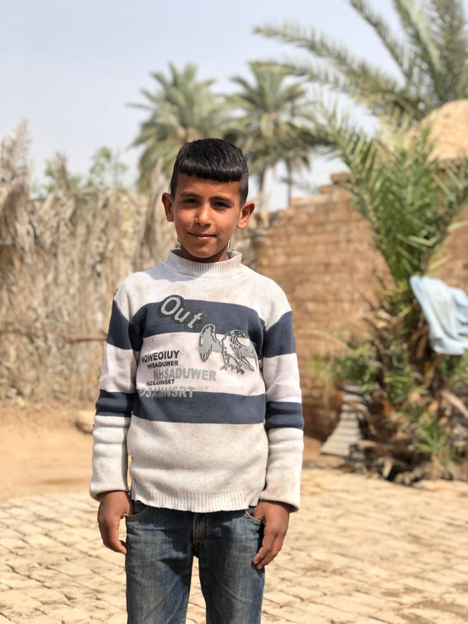 10-year-old Ahmed at Al-Mahatta displacement camp in Iraq.