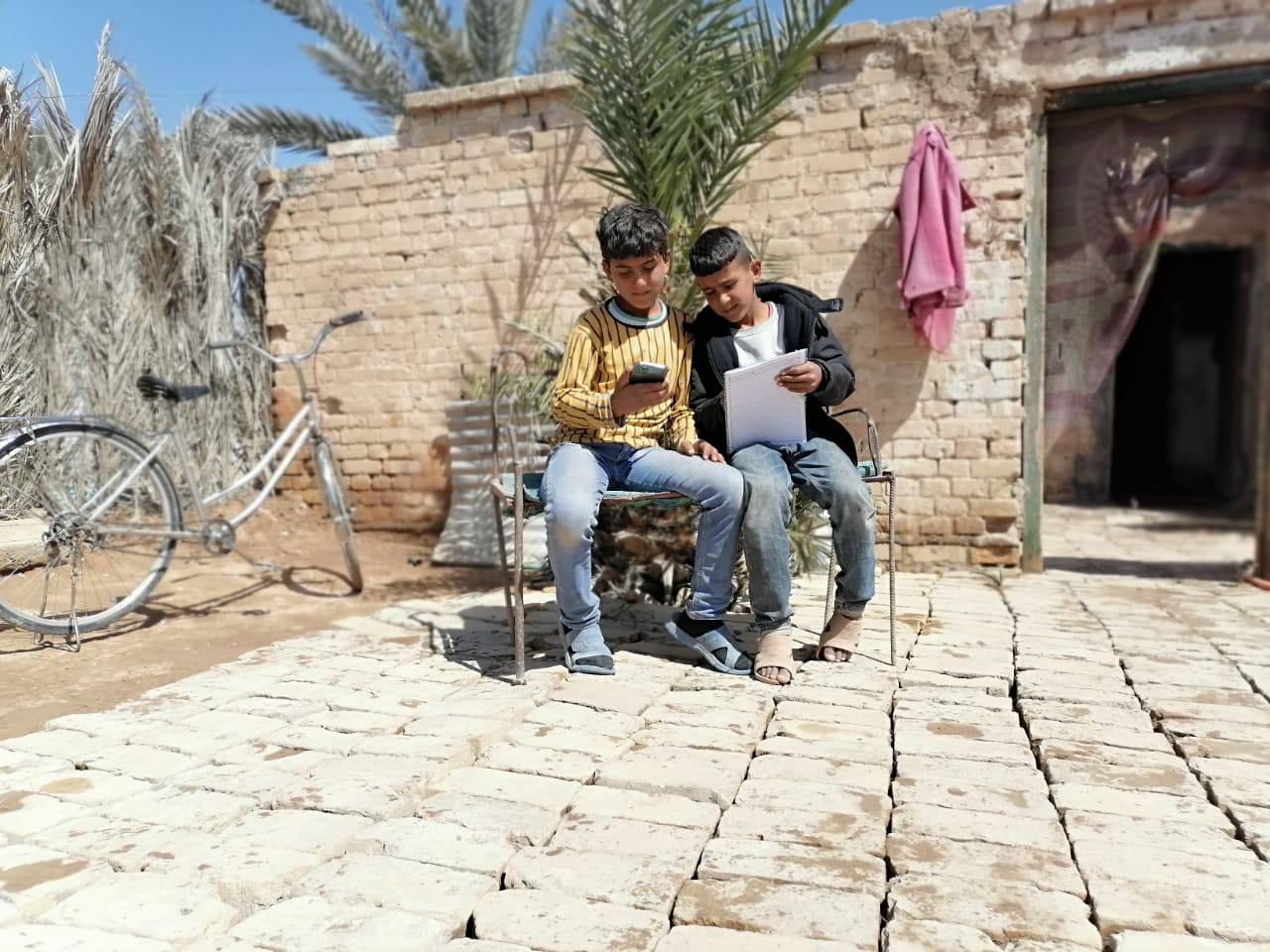 Ahmed and his friend at Al-Mahatta displacement camp in Iraq.