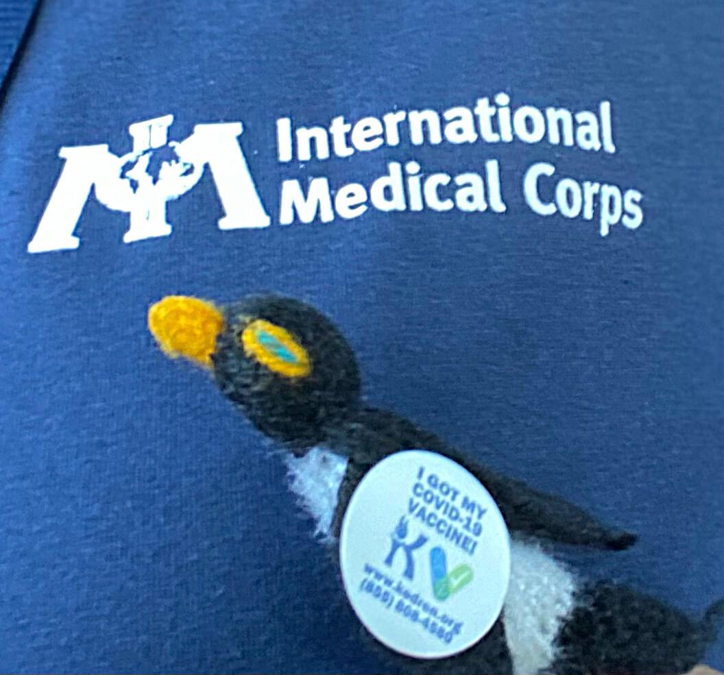 Pengui - Yvonne's avatar - shows off his vaccine sticker.