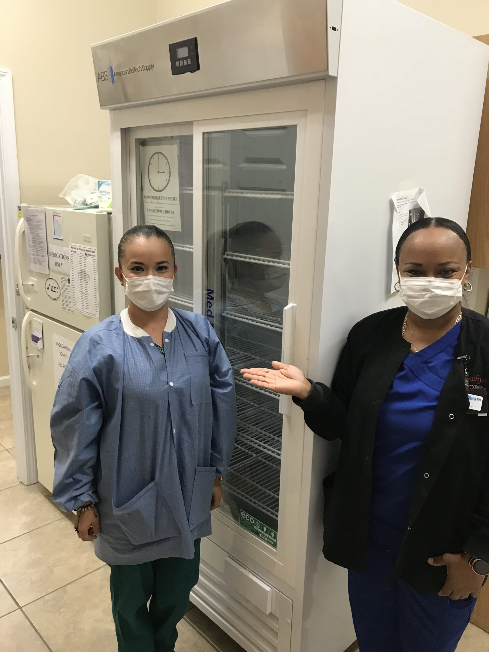 Nadiya Perry and Daniela Mesia from PanCare Health's medical clinic in Freeport, Florida, with new pharmacy refrigerators donated by International Medical Corps.