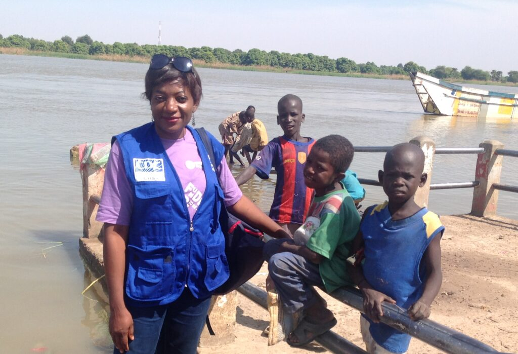 Dr. Dissake with children in the Mada health district, near Lake Chad in Cameroon.