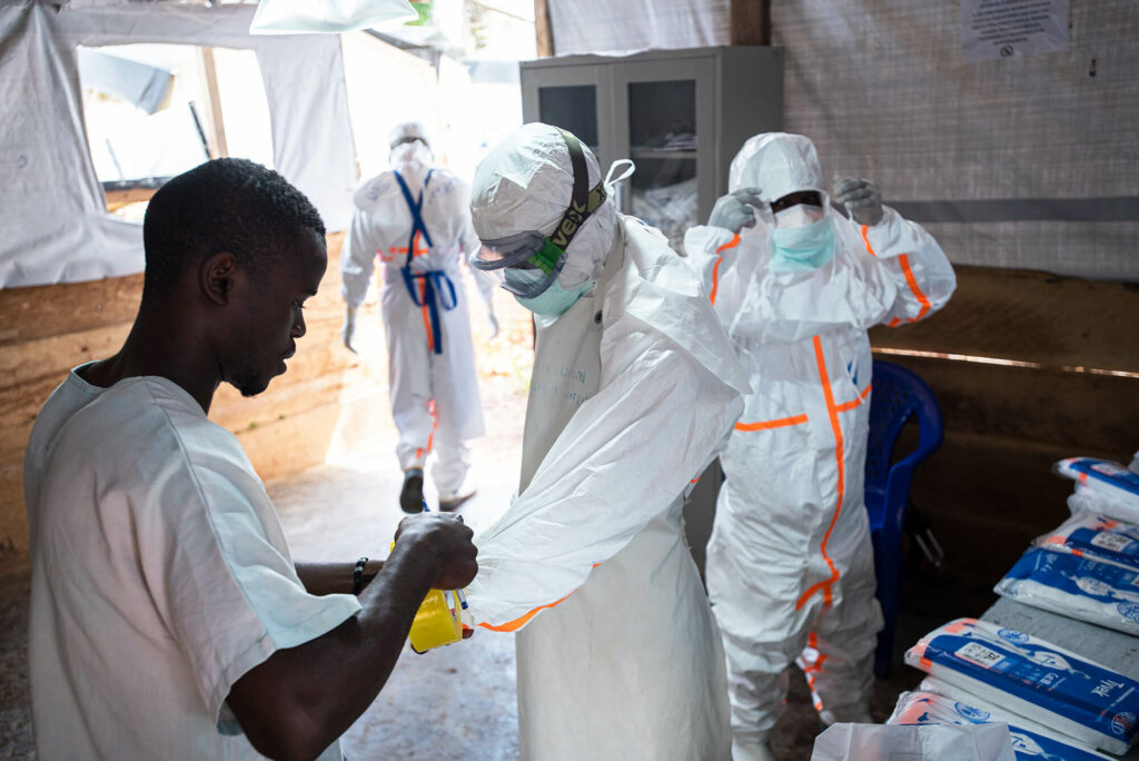 Medical staff in DRC don PPE before entering an area where patients with Ebola are quarantined.