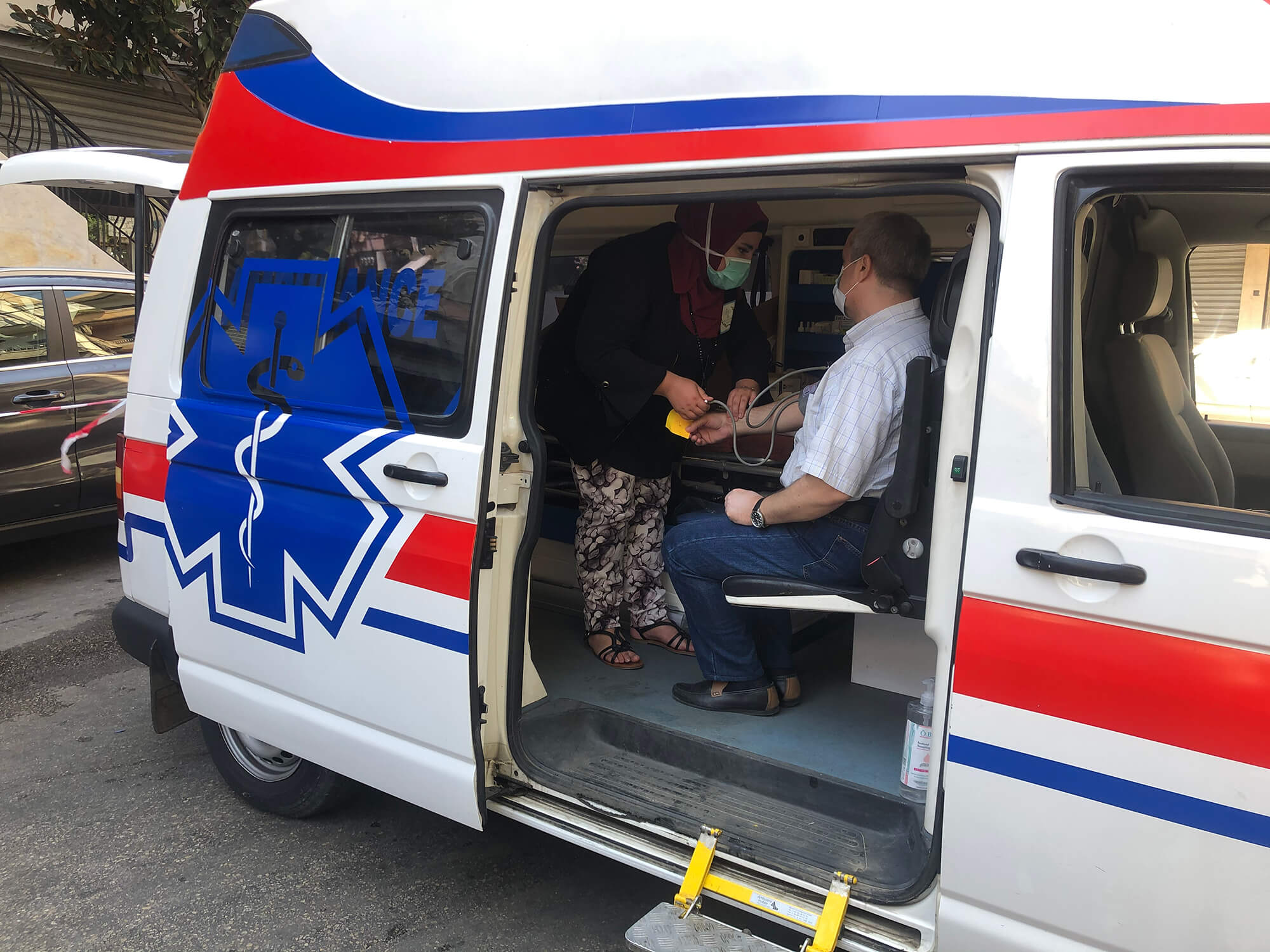 A patient receives services in a mobile medical unit in Borj Hammoud.