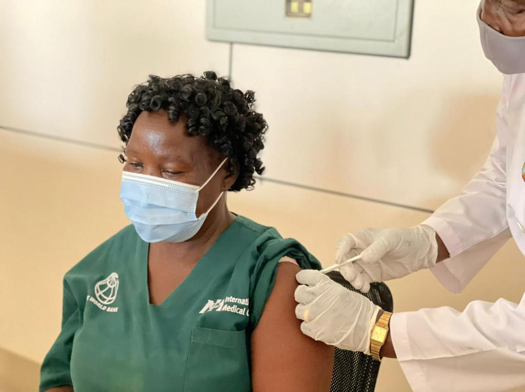 A healthcare worker in Juba, South Sudan, receives the COVID-19 vaccine.