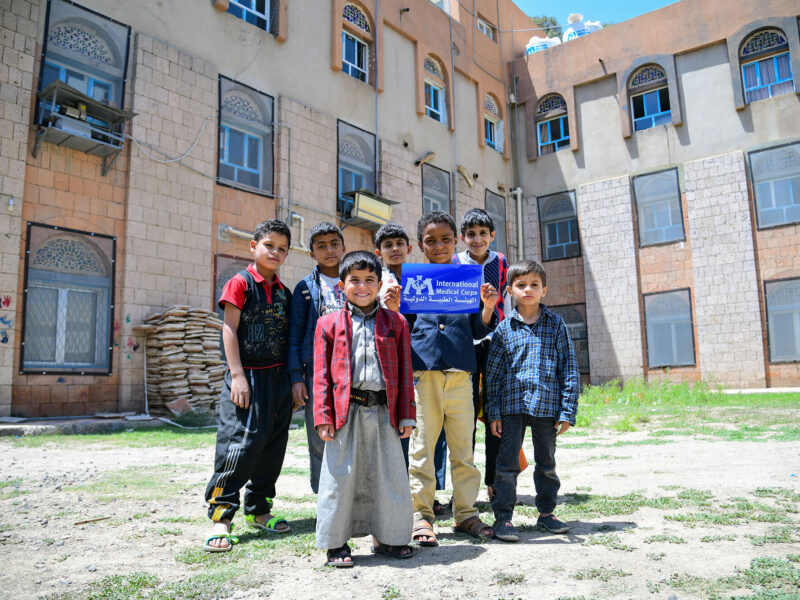 Young residents of the orphanage pose outside the refurbished clinic.