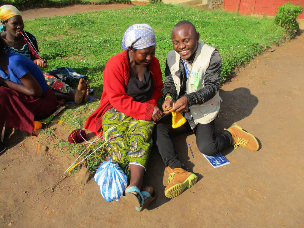 Mussa learning how to knit in North Kivu Province.