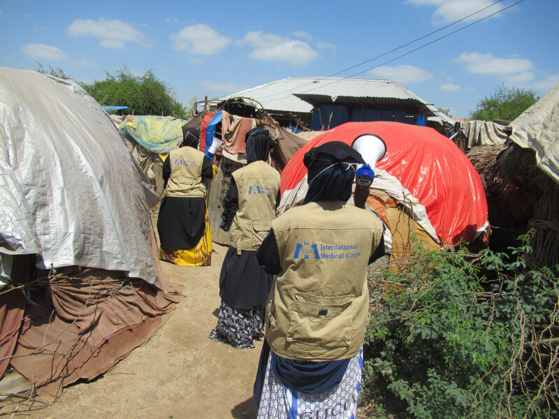 Female health workers spread awareness and educate the community about COVID-19 in an IDP camp in Somalia.