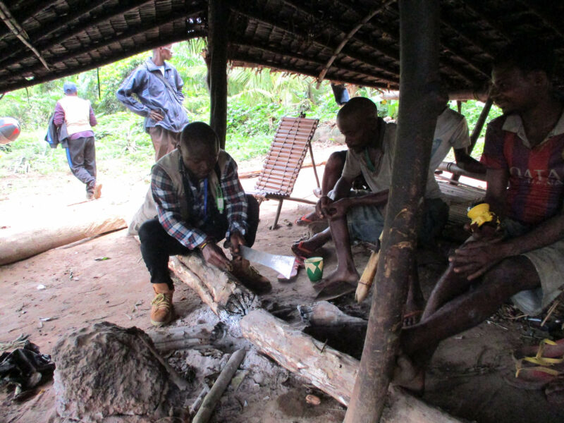 The blog's author, Mussa Kachunga Stanis, greets local villagers during an assessment in Itipo Village in Equateur province.