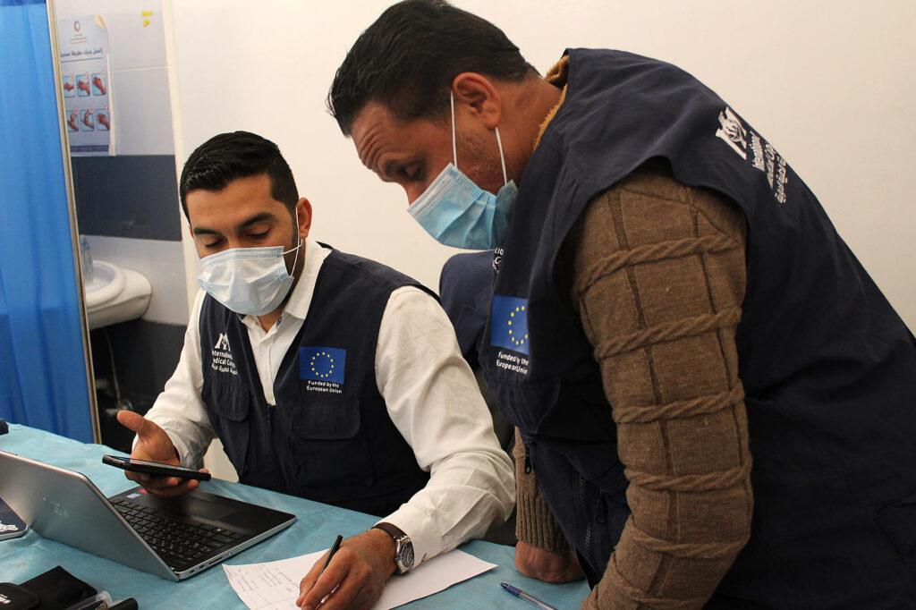 Dr. Sanad Attia and Khaled Hassan, a nurse, review files at Al-Medina Al-Kadima primary healthcare center (PHCC) in Tripoli.