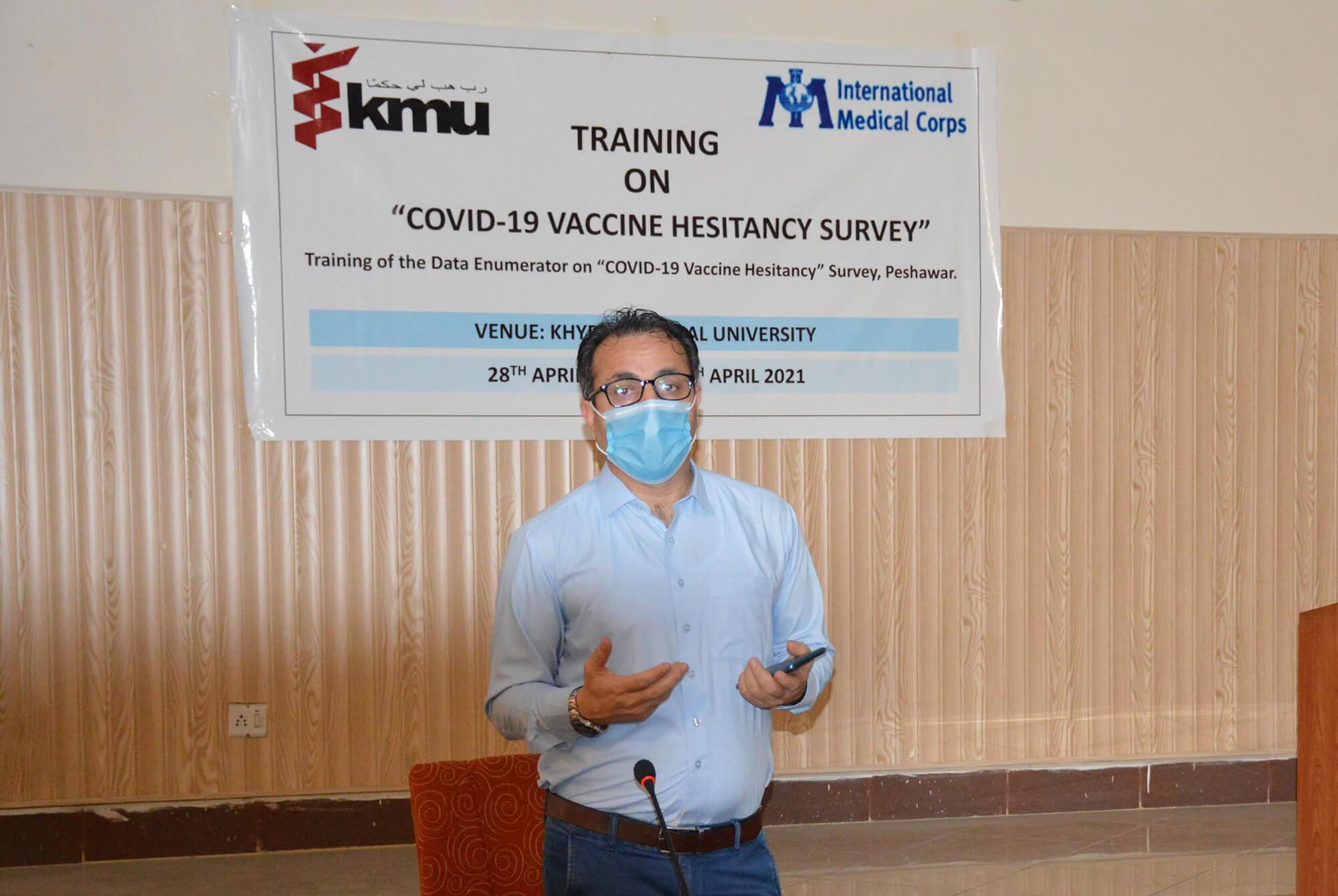 Dr. Khalid Rehman trains data collectors for our vaccine hesitancy survey.