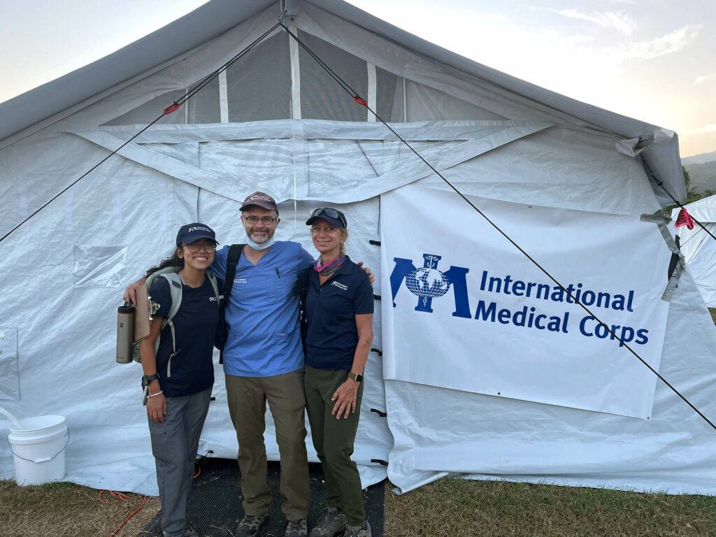 Outside the EMT, Sue Mangicaro (left) poses with Dr. Chad Knaus and volunteer Lila Olman.