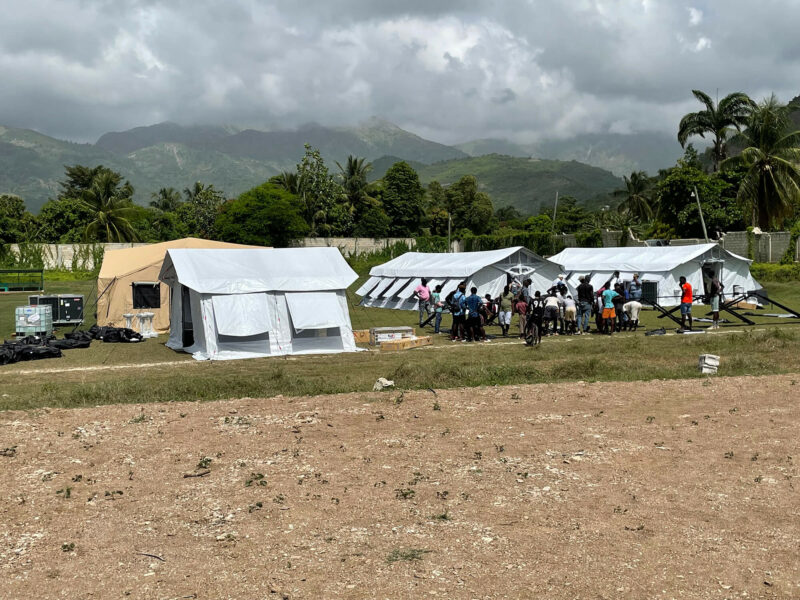 With the help of staff, volunteers and local community members, International Medical Corps overcame a mammoth logistical challenge and set up its EMT in Aquin, Haiti, in a matter of days.